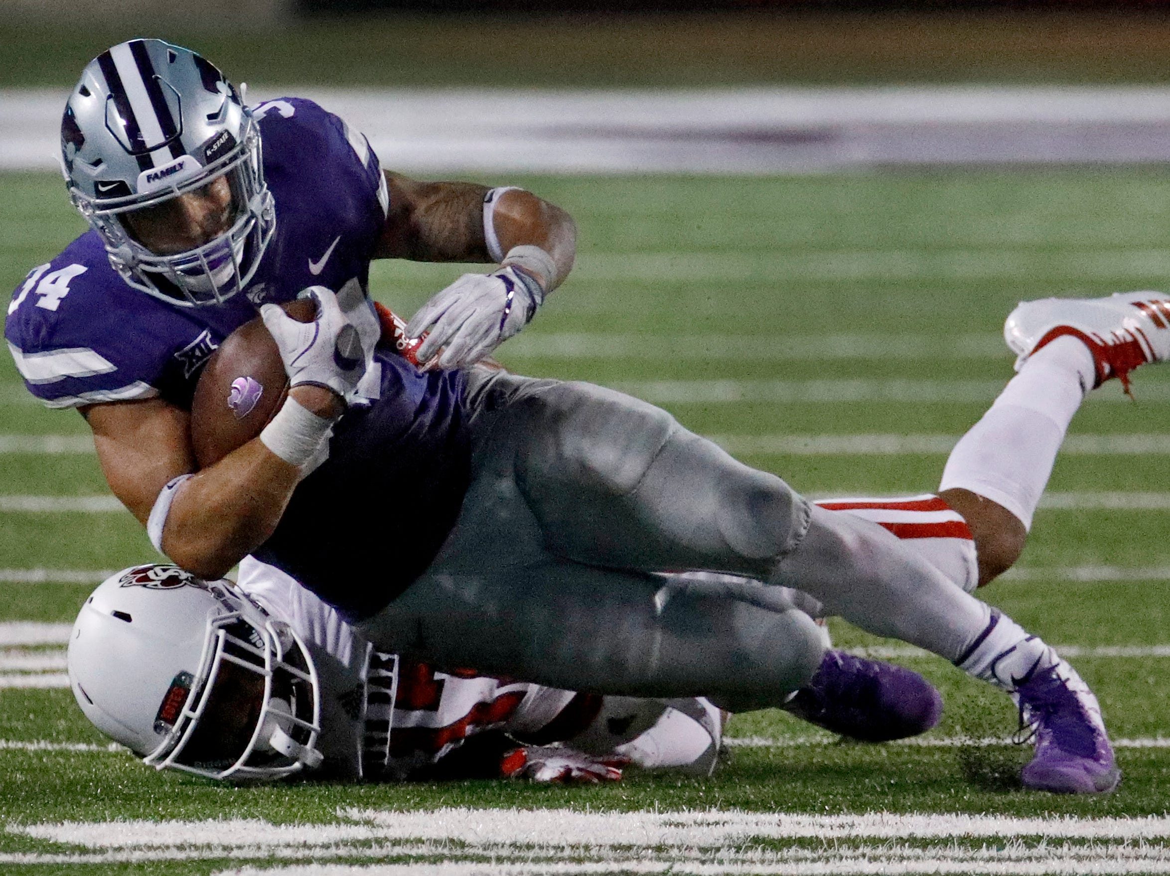 Kansas State running back Alex Barnes (34) is brought down by South Dakota defensive back Cameron Tisdale during the second half of an NCAA college football game Saturday, Sept. 1, 2018, in Manhattan, Kan. Kansas State won 27-24. (AP Photo/Charlie Riedel)