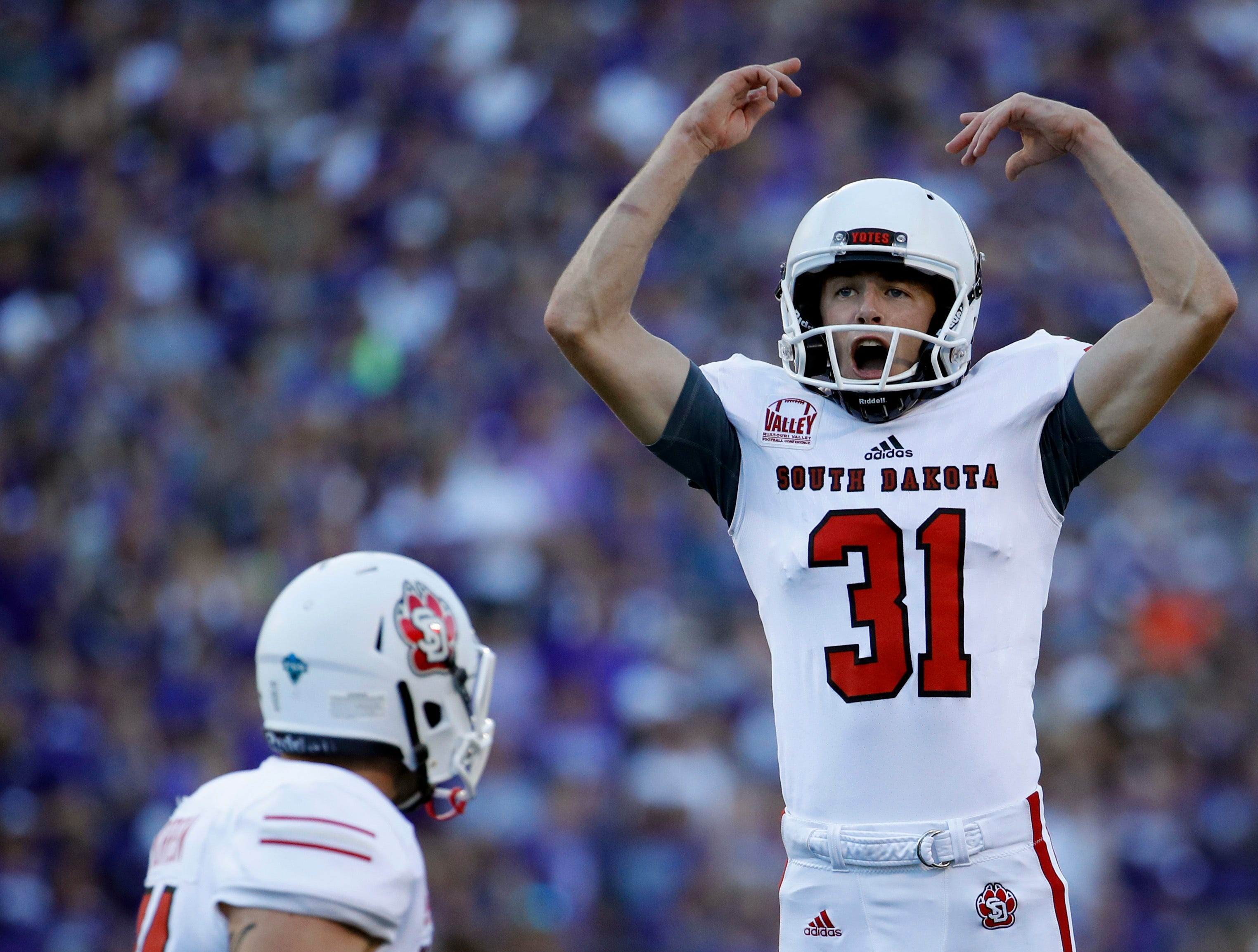 South Dakota place kicker Mason Lorber (31) celebrates after making a field goal during the first half of an NCAA college football game against Kansas State Saturday, Sept. 1, 2018, in Manhattan, Kan. (AP Photo/Charlie Riedel)