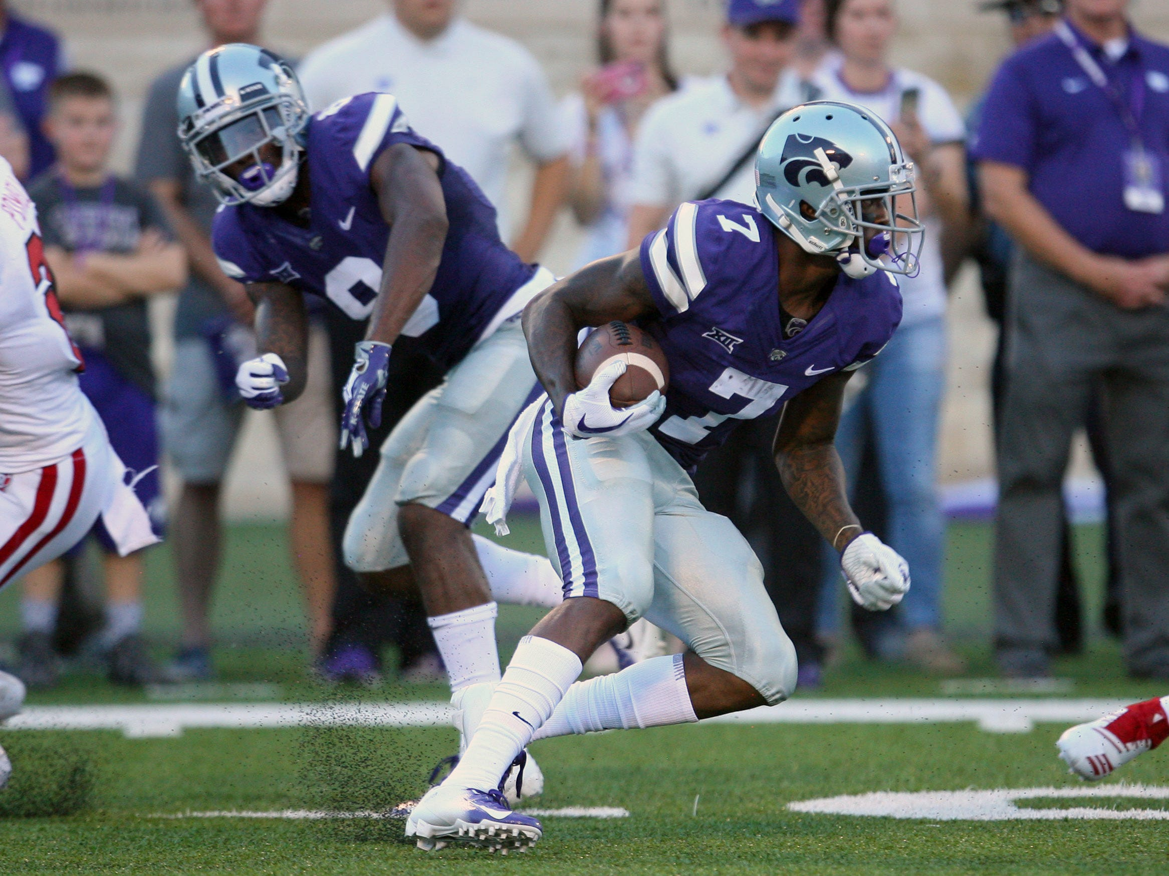 Sep 1, 2018; Manhattan, KS, USA; Kansas State Wildcats wide receiver Isaiah Zuber (7) looks for carries the ball against the South Dakota Coyotes at Bill Snyder Family Stadium. Mandatory Credit: Scott Sewell-USA TODAY Sports