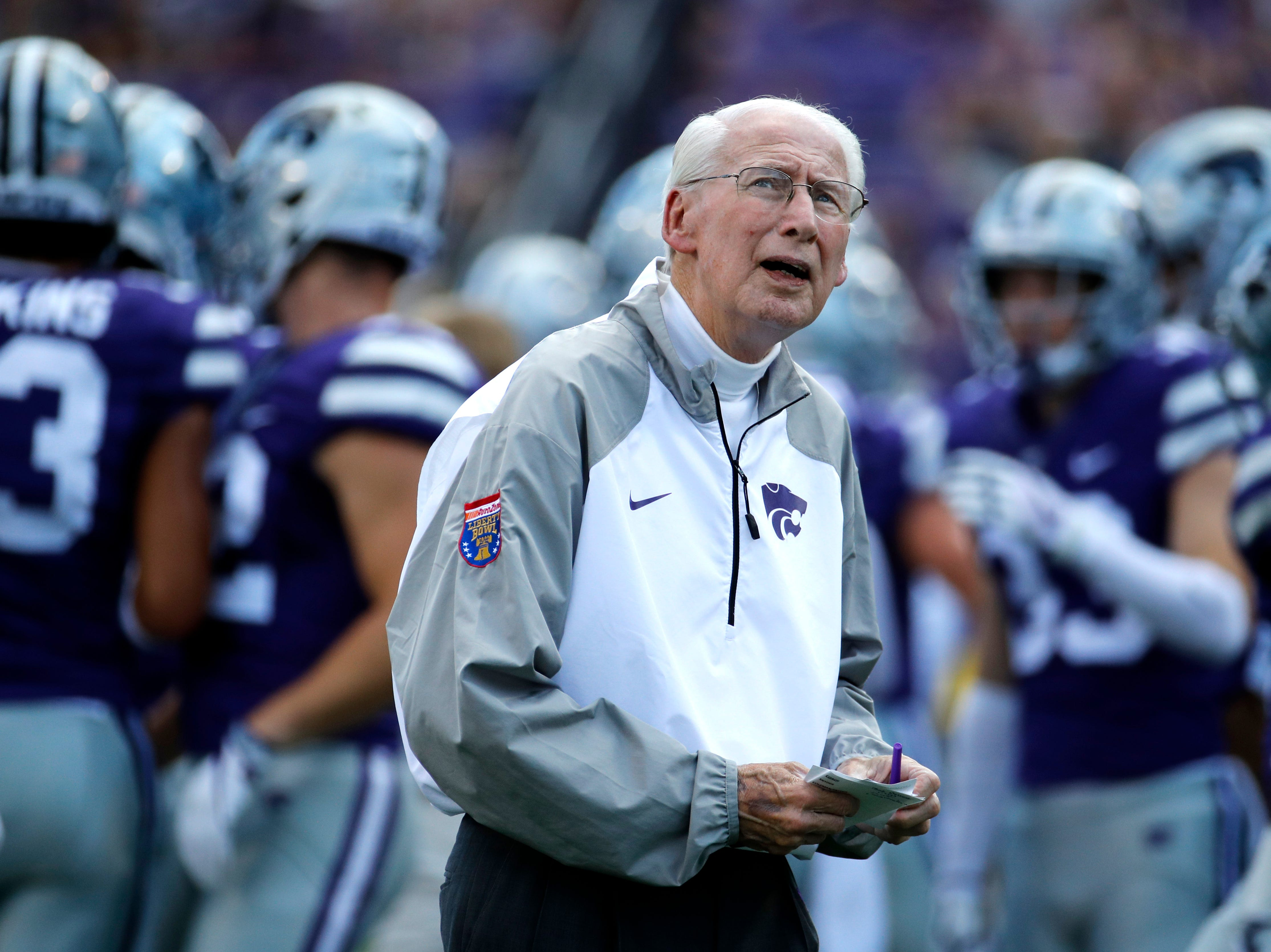 Kansas State head coach Bill Snyder watches his team warm up before an NCAA college football game against the South Dakota Saturday, Sept. 1, 2018, in Manhattan, Kan. (AP Photo/Charlie Riedel)