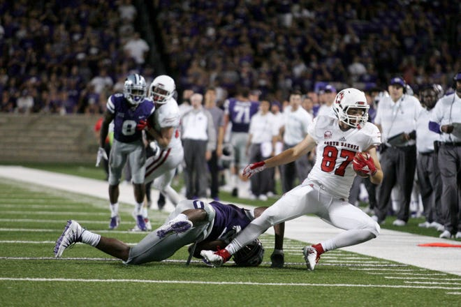 Sep 1, 2018; Manhattan, KS, USA; South Dakota Coyotes tight end Connor Herrmann (87) makes a catch against Kansas State Wildcats linebacker Da'Quan Patton (5) during the fourth quarter at Bill Snyder Family Stadium. The Wildcats won 27-24. Mandatory Credit: Scott Sewell-USA TODAY Sports