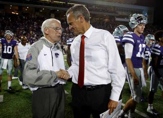Kansas State head coach Bill Snyder, left, and South Dakota head coach Bob Nielson talk after their NCAA college football game Saturday, Sept. 1, 2018, in Manhattan, Kan. Kansas State won 27-24. (AP Photo/Charlie Riedel)