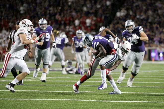 Sep 1, 2018; Manhattan, KS, USA; Kansas State Wildcats wide receiver Isaiah Zuber (7) is tackled by South Dakota Coyotes defensive back Phillip Powell (21) during the fourth quarter at Bill Snyder Family Stadium. The Wildcats won 27-24. Mandatory Credit: Scott Sewell-USA TODAY Sports