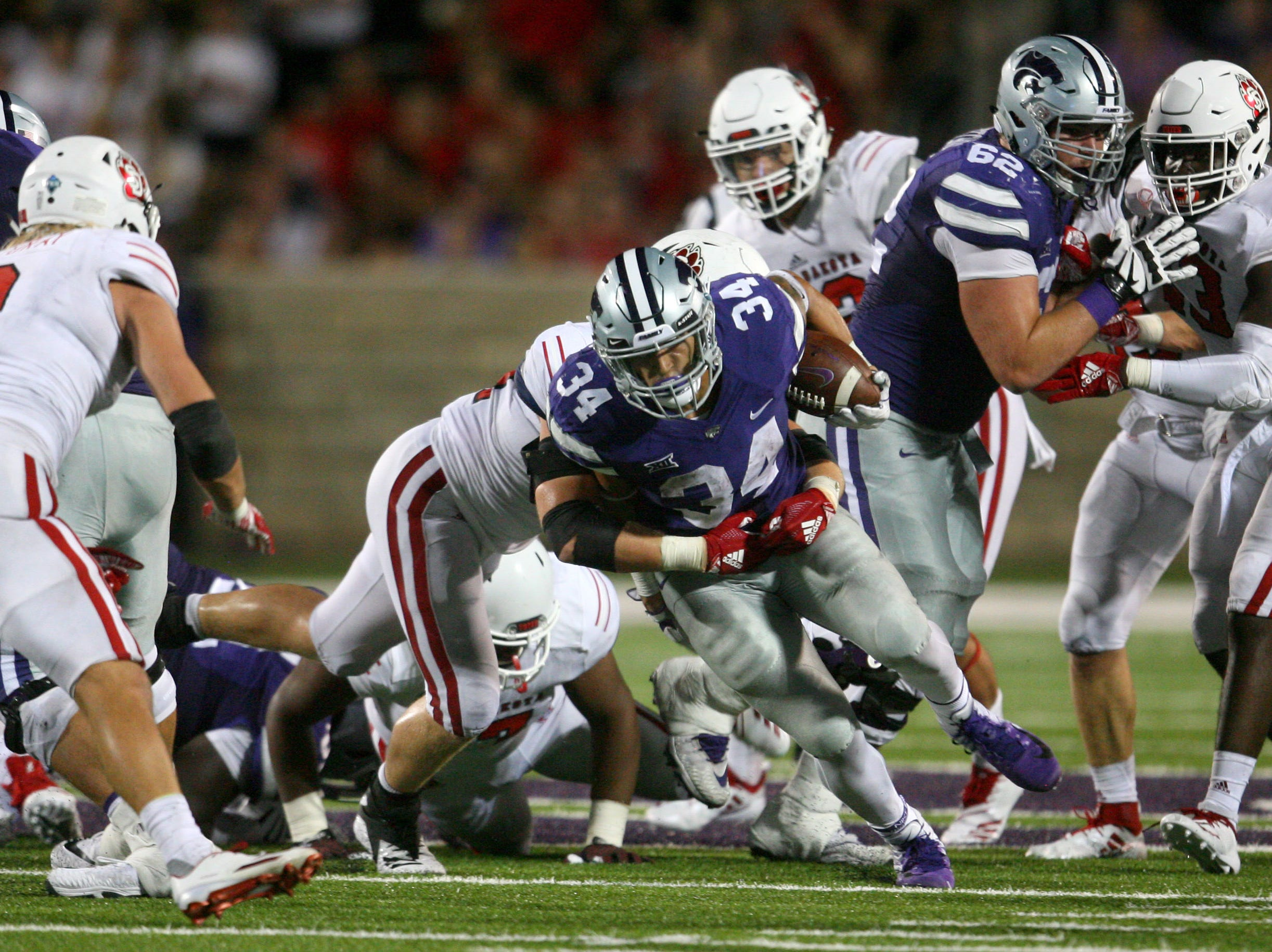 Sep 1, 2018; Manhattan, KS, USA; Kansas State Wildcats running back Alex Barnes (34) is tackled by South Dakota Coyotes defensive lineman Darin Greenfield (44) during the fourth quarter at Bill Snyder Family Stadium. The Wildcats won 27-24. Mandatory Credit: Scott Sewell-USA TODAY Sports