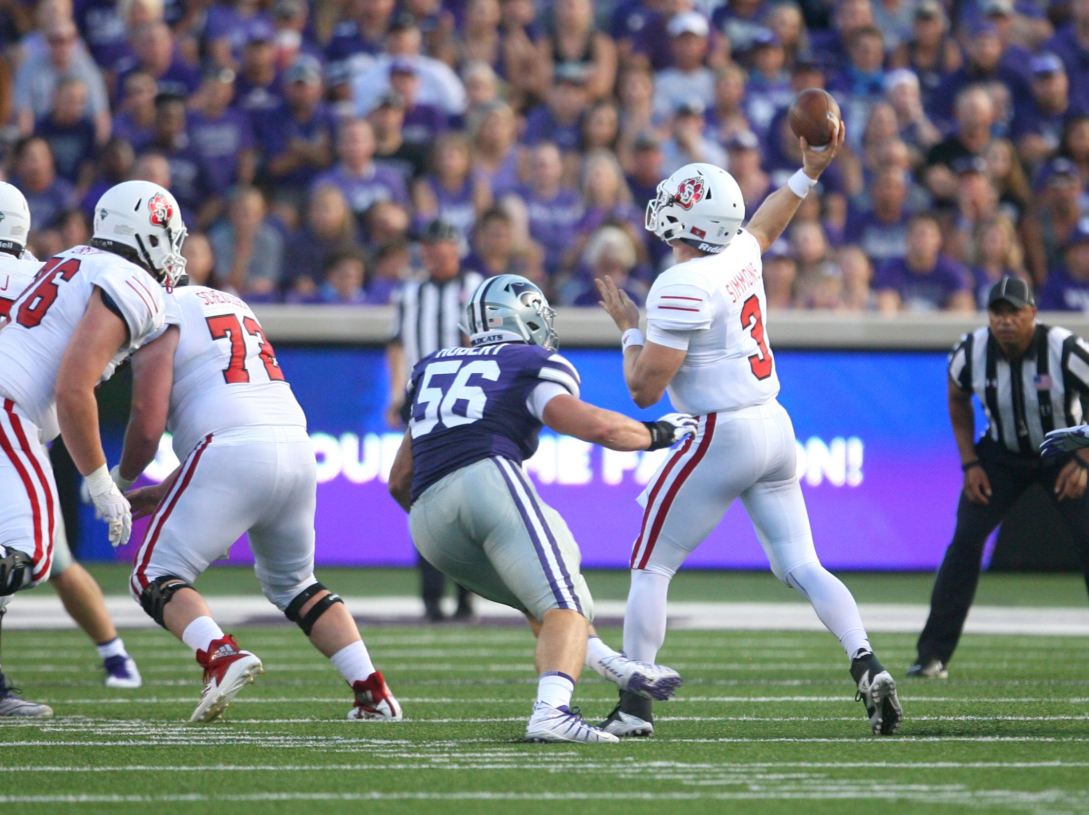 Sep 1, 2018; Manhattan, KS, USA; South Dakota Coyotes quarterback Austin Simmons (3) is pressured by Kansas State Wildcats defensive end Wyatt Hubert (56) at Bill Snyder Family Stadium. Mandatory Credit: Scott Sewell-USA TODAY Sports