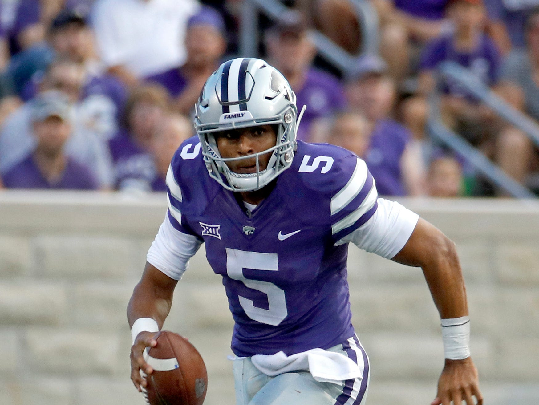 Kansas State quarterback Alex Delton (5) runs the ball for a first down during the first half of an NCAA college football game against South Dakota Saturday, Sept. 1, 2018, in Manhattan, Kan. (AP Photo/Charlie Riedel)