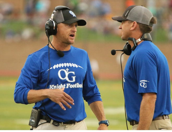 O'Gorman coaches Shannon Poppinga (L) and Jayson Poppinga (R) talk after an O'Gorman touchdown during Saturday's game against Harrisburg in Harrisburg.