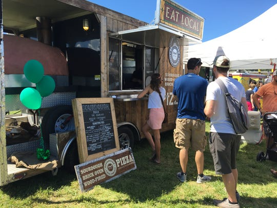 The battle wouldn't have been complete without a truck specializing in pizza. Customers wait for the brick oven style pizza at the 4th annual Virginia Food Truck Battle.