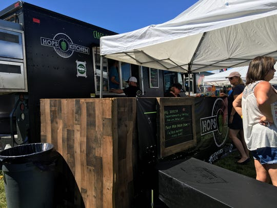 Hops Kitchen serves a line of customers at the Virginia Food Truck Battle