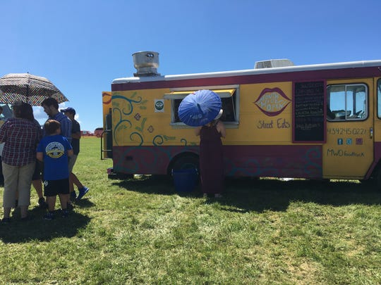 It was hot, but that didn't stop individuals from tasting food from each truck at the event Sunday.