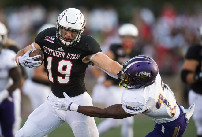 Southern Utah University tight end Logan Parker (19) stiff arms his opponent during the first half of the season opener against North Alabama University at Eccles Coliseum  Saturday, September 1, 2018. SUU is up at the half, 16-13.