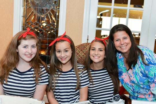 Ainsley Channon, left, Olivia Buck, Makayla McSweeney and Malissa Morgan attend Main Street Fort Pierce's 24th annual Reverse Raffle at the Pelican Yacht Club in Fort Pierce.