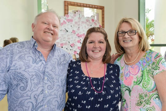 Greg Childress, left, with Hearts of Hope Bingo co-chairs Charlotte LaChance and Carol Bishop.