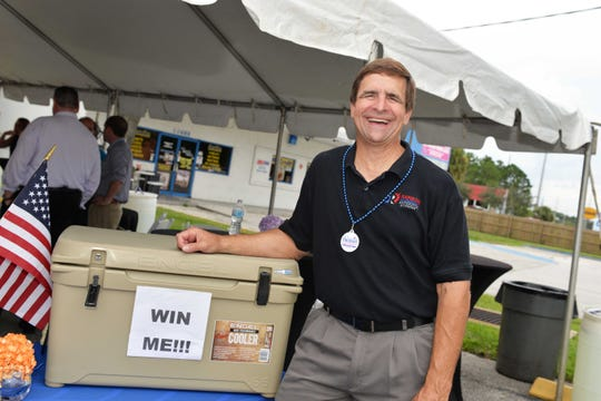 David Guezerix of Rainbow International, won the Engle eooler raffle drawing at the Treasure Coast Builders Association's Fun After Five networking event.