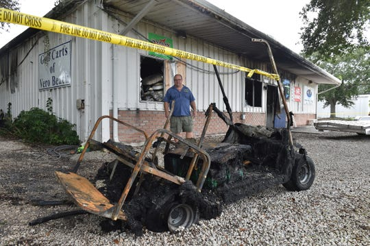 Tim Burklew, owner of Golf Carts of Vero Beach, surveys damage to the business after fire broke out early Sunday, Sept. 2, 2018, destroying nearly 100 golf carts and the building in the 3400 block of Aviation Boulevard in Vero Beach.
