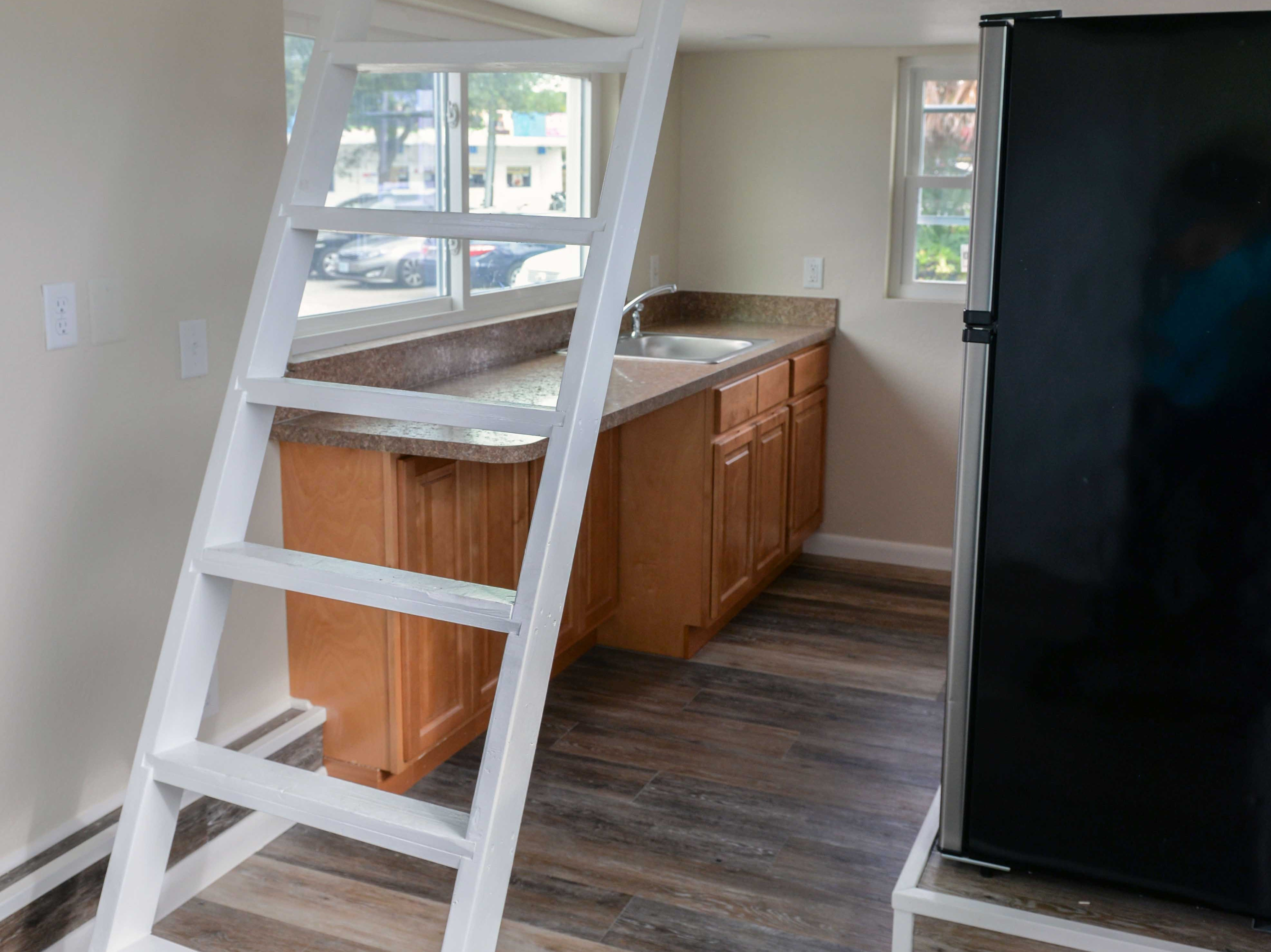 The Diamond Lil' Tiny Home features a kitchen with full-size appliances, space and connections for stackable washer/dryer, living area and two lofts, and bathroom with toilet, shower, sink, closet.