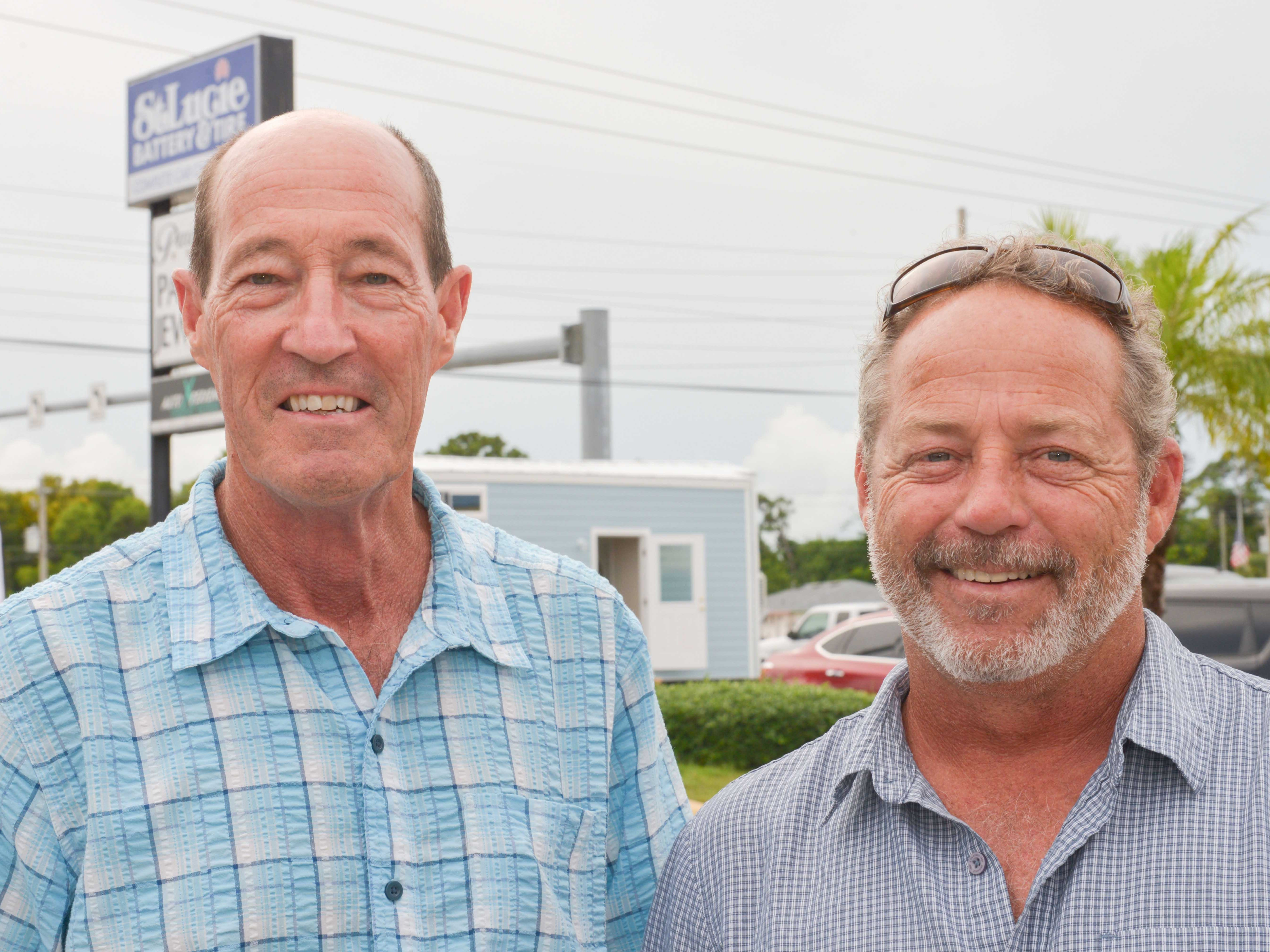 Bob Calhoun, left, executive director of St. Lucie Habitat for Humanity and Treasure Coast Builders Association board member;and Doug Miller, president of St. Lucie Battery & Tire.