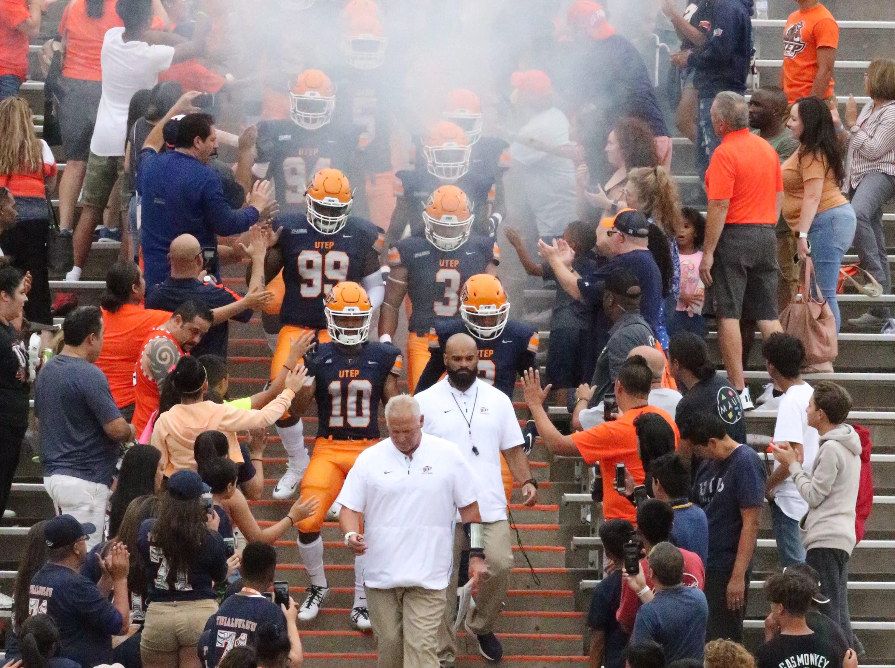 UTEP head football coach Dana Dimel heads out of the Mine Shaft with the team Saturday night.
