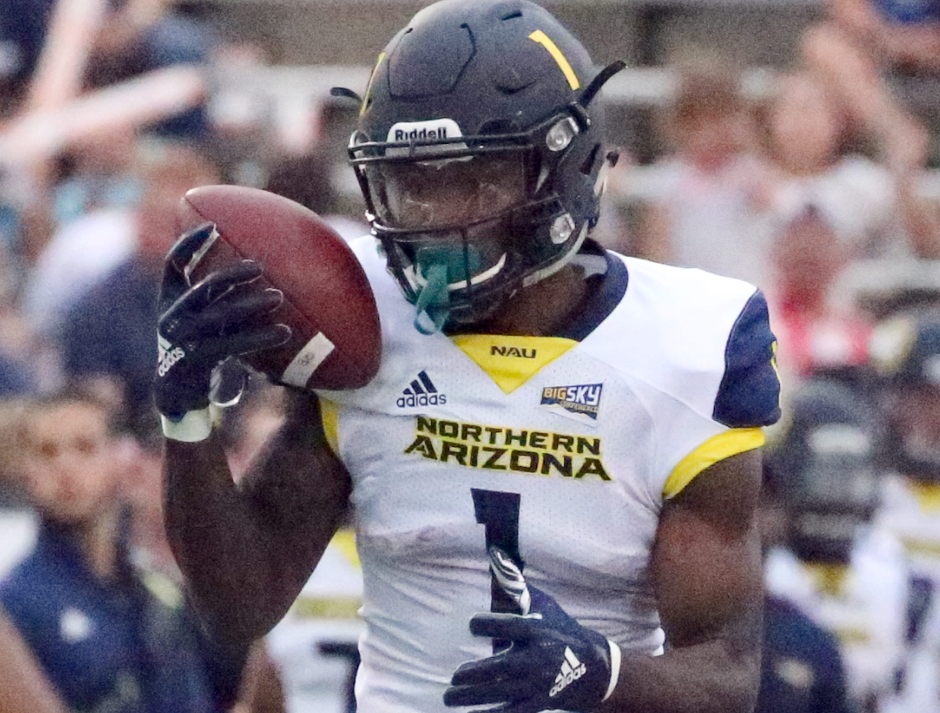 Northern Arizona wide receiver Emmanuel Butler manages to hold on to a throw before sprinting into the end zone for the Lumberjacks' second touchdown against UTEP Saturday night.