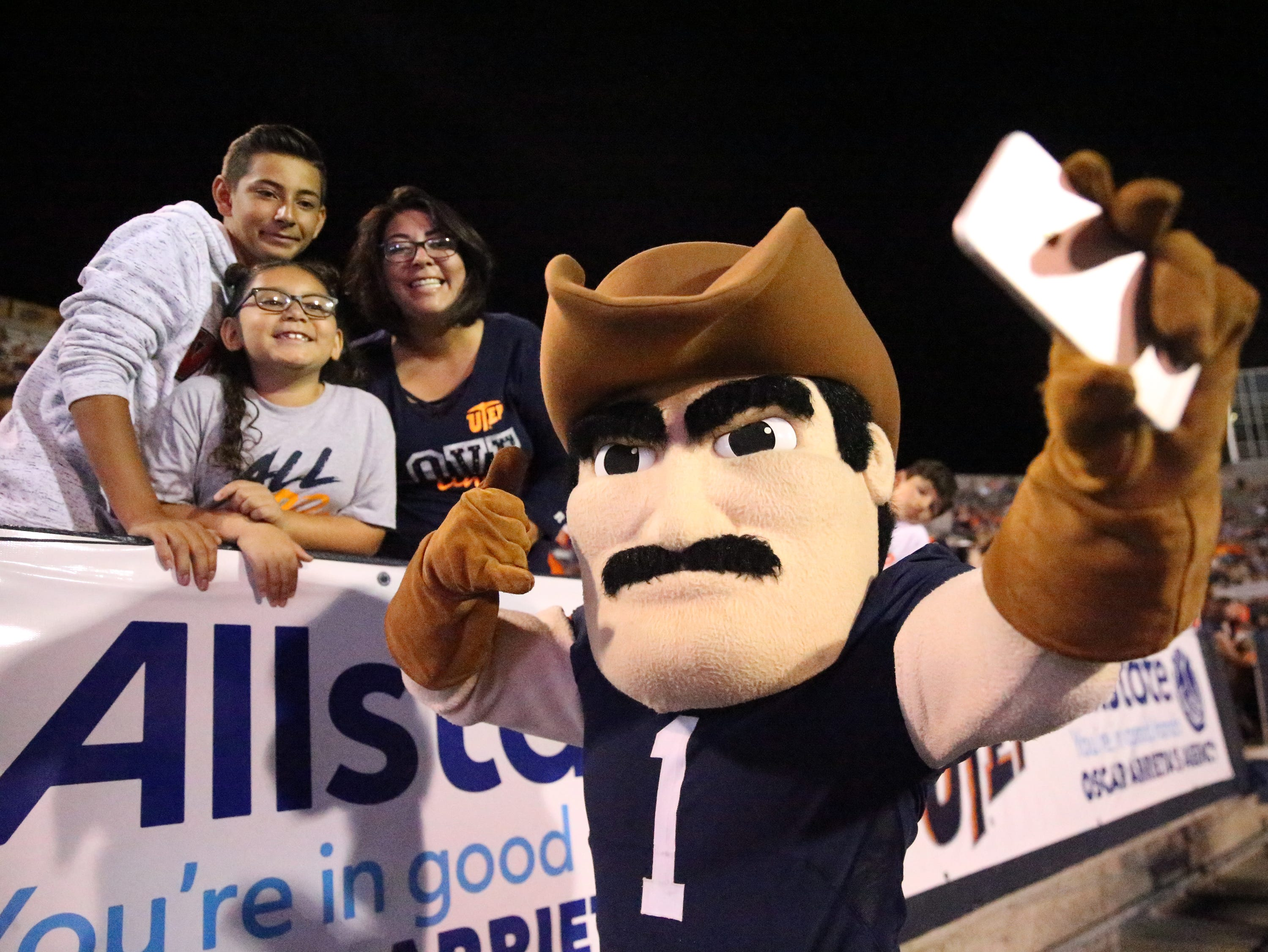 UTEP mascot Paydirt Pete does a selfie with Lauren Nuñez and her children Zachary and Elizabeth Saturday in the Sun Bowl Stadium.