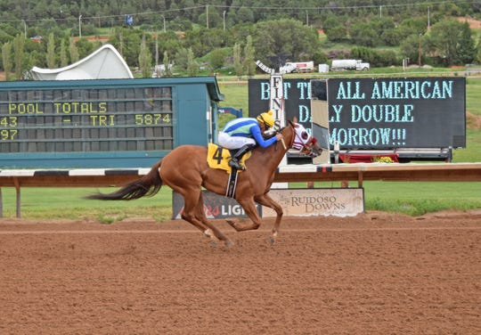 Diabolical Gator wins for owners Judy and Kirk Robison on Saturday in Ruidoso.