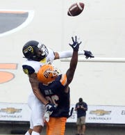 UTEP 's Walter Dawn Jr. reaches for a pass with Northern Arizona safety Wes Sutton Saturday.