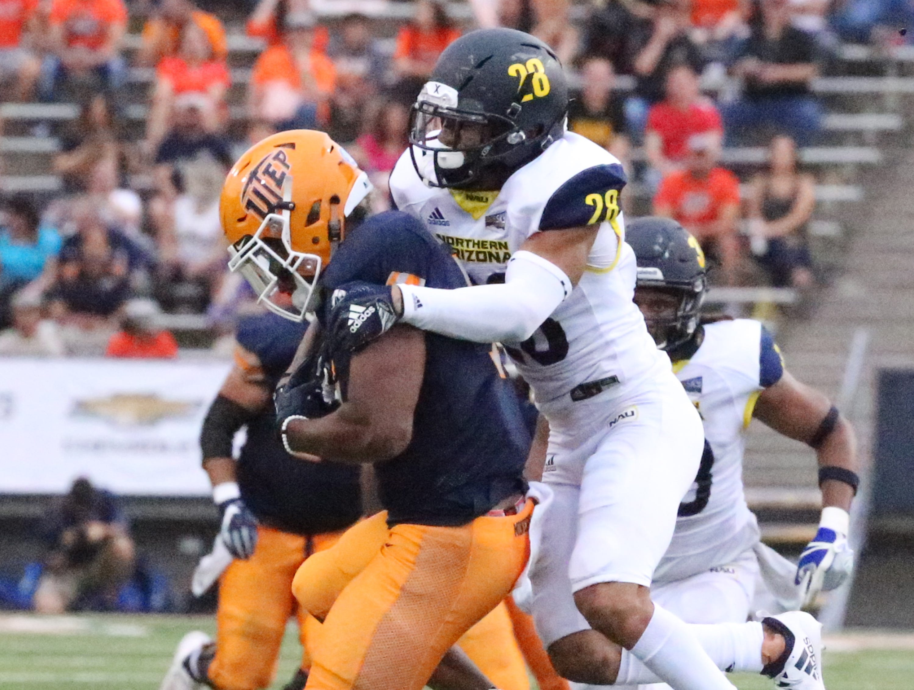 UTEP wide receiver Kavika Johnson, 7, could not catch the throw while being chased by Northern Arizona safety Wes Sutton, 28, Saturday night in the Sun Bowl.