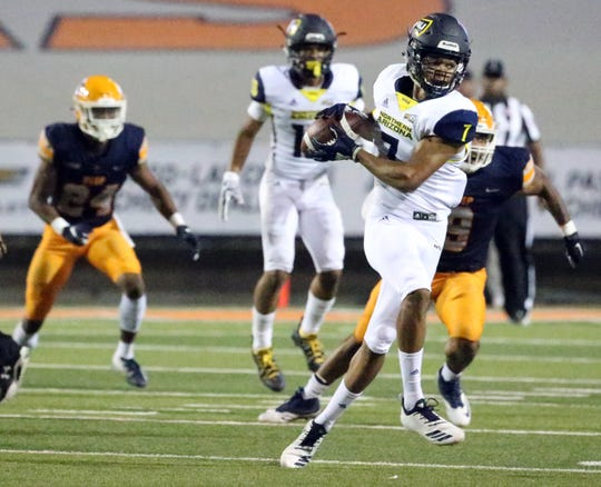 Northern Arizona wide receiver Chancellor Brewington, 7, catches a short pass late in the fourth quarter against UTEP Saturday night.