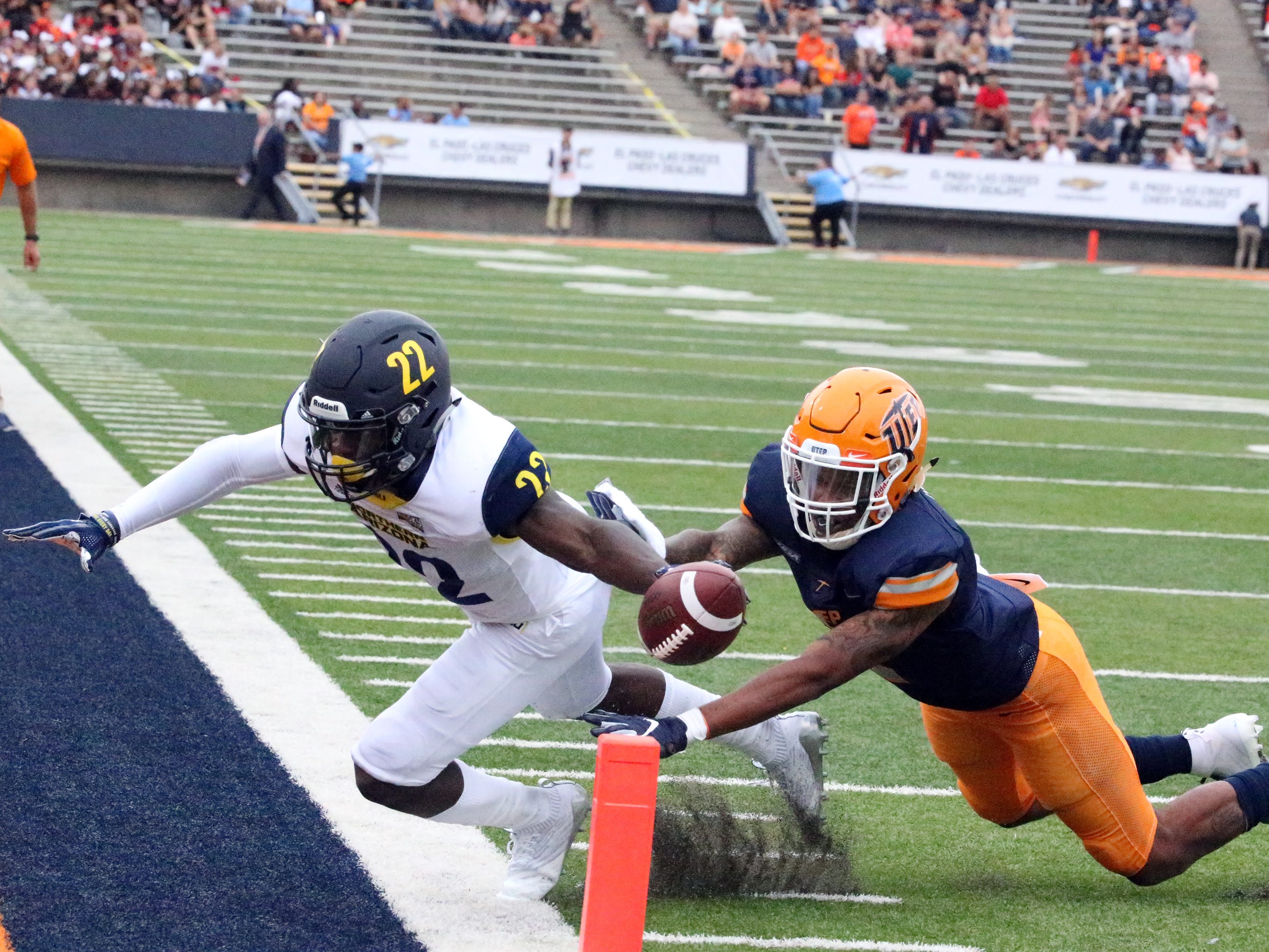 Joe Logan, 22, of Northern Arizona steps out of bounds just as he carries the ball over the hash mark Saturday against UTEP. The touchdown call was recalled after review but the Lumberjacks scored on the next play.