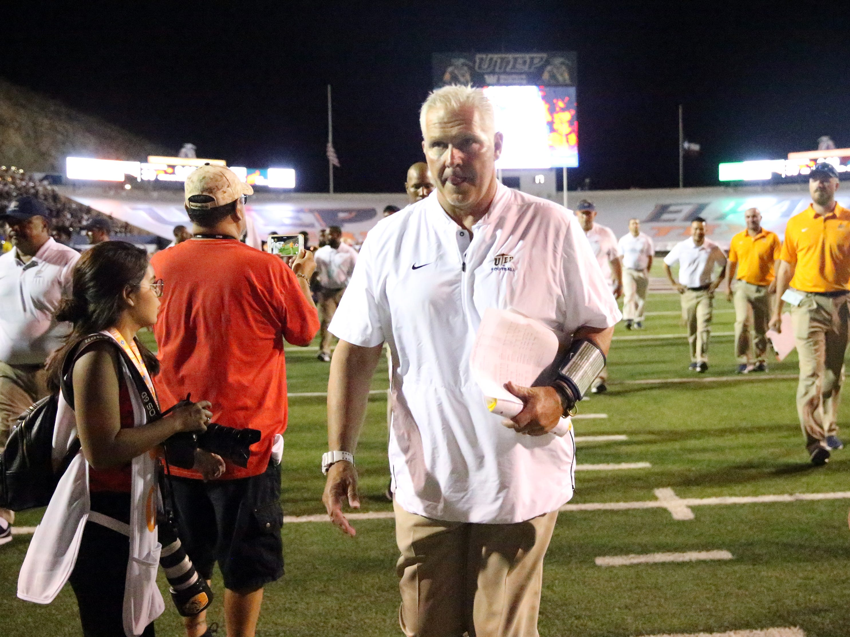 UTEP head football coach Dana Dimel leaves the Sun Bowl playing field following the Miner's season opening loss to Northern Arizona 30-10 Saturday.
