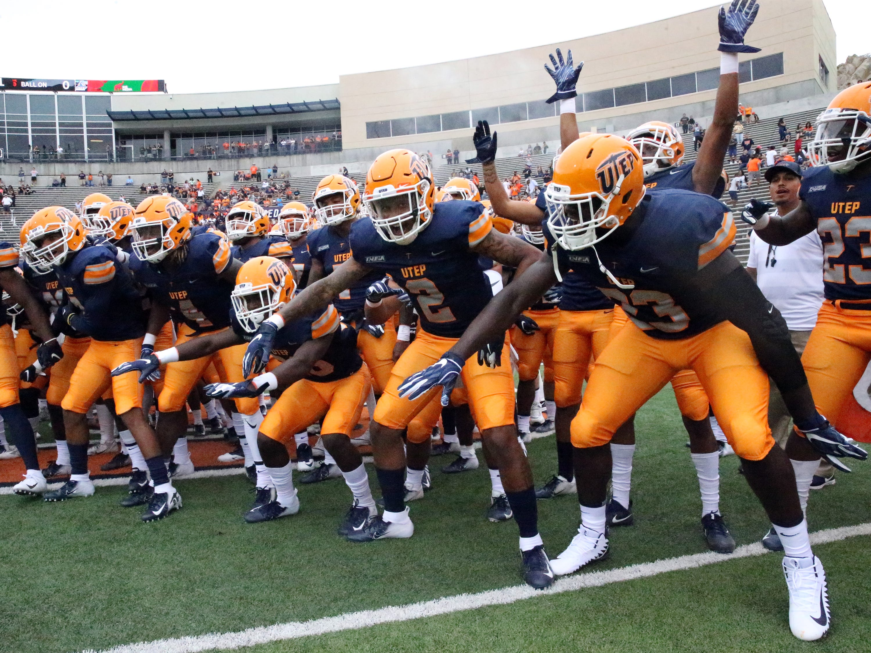 The UTEP football team rallies at the start of the season opener against Northern Arizona on Sept. 1.