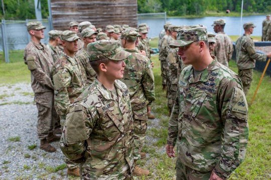 Staff Sgt. Amanda F. Kelley graduated from the U.S. Army Ranger School in Fort Benning, Ga., on Friday. She is the first enlisted woman to earn the Ranger tab.