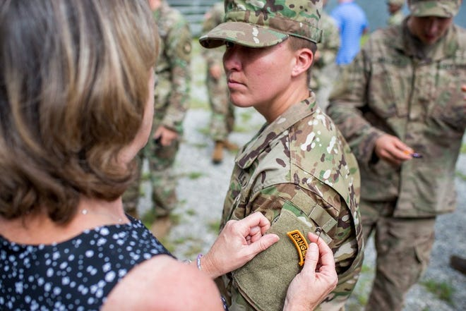 Staff Sgt. Amanda F. Kelley receives her Ranger tab after graduating from the U.S. Army Ranger School in Fort Benning, Ga., on Friday. She is the first enlisted woman to earn the Ranger tab.