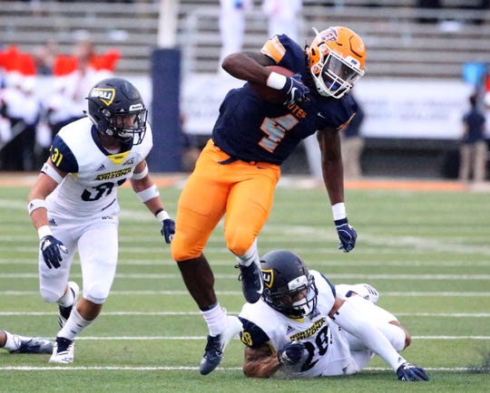 UTEP junior running back Quadraiz Wadley, 4, breaks away from the last Northern Arizona defender as he sprints to the end zone for UTEP's first score before the end of the first half Saturday night in the Sun Bowl Stadium.