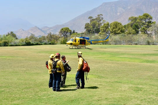 Emergency crews discuss a large animal rescue above Ojai's Thacher School Sunday afternoon.