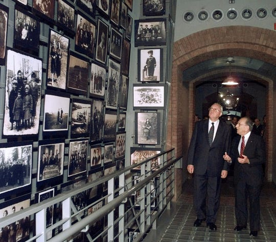 German President Roman Herzog, left, and Miles Lerman, chairman of the U.S. Holocaust Memorial Museum, walk into the museum's Tower of Life, during the president's tour of the museum in Washington in this July 23, 1997 file photo.