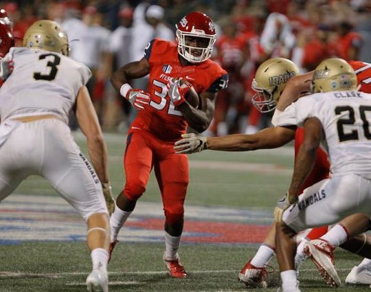 Fresno State running back Romello Harris looks to run past Idaho defensive back Dorian Clark during the second half of an NCAA college football game in Fresno, Calif., Saturday, Sept. 1, 2018. (AP Photo/Gary Kazanjian)