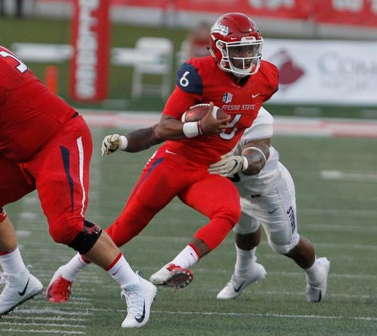 Fresno State quarterback Marcus McMaryion looks for running room against Idaho during the first half of an NCAA college football game in Fresno.