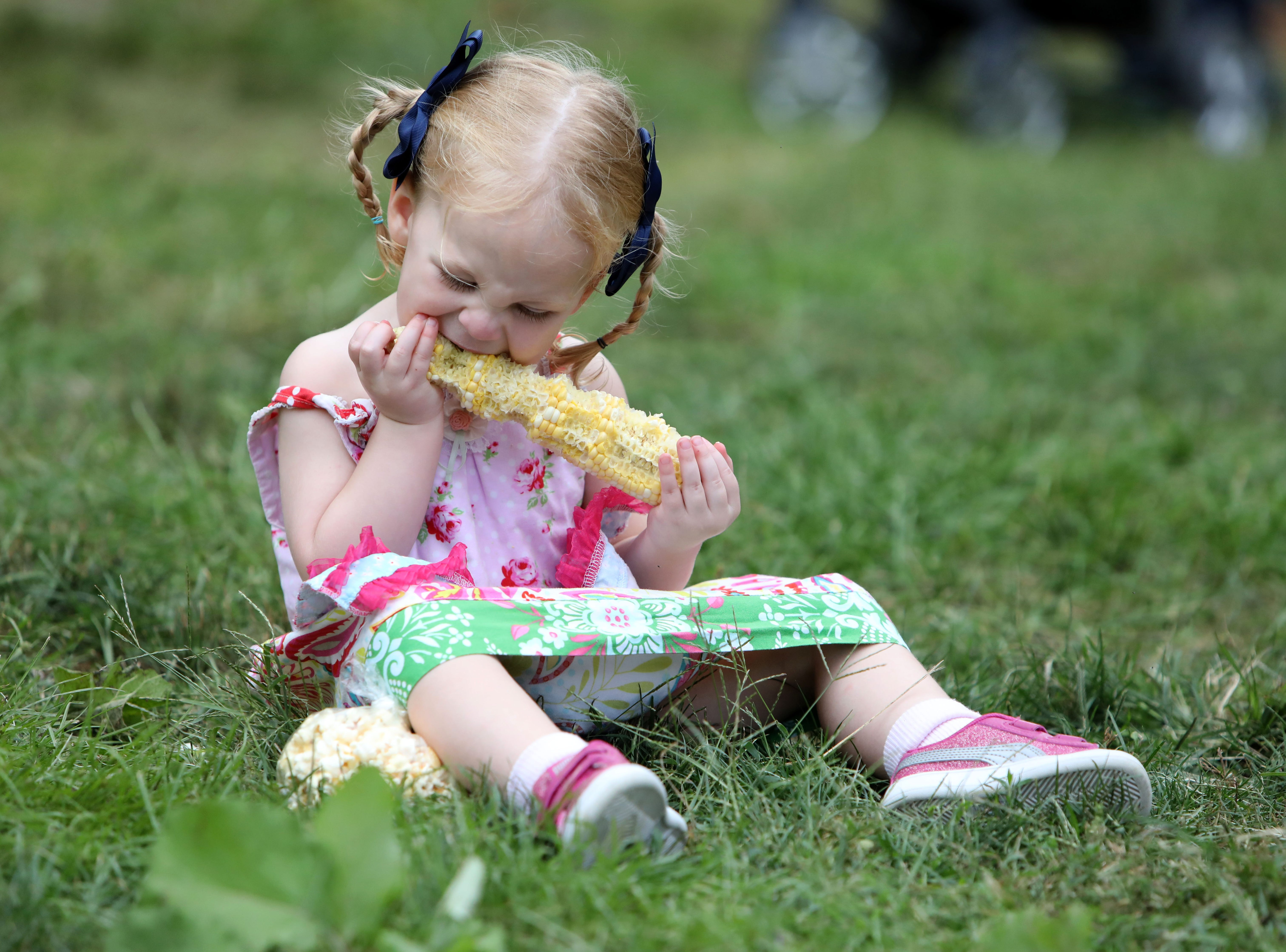 Niav Fay, 2, of Croton eats fresh corn at Cornucopia, a festival celebrating corn and all things harvest related, at Philipsburg Manor Sept. 2, 2018 in Sleepy Hollow.