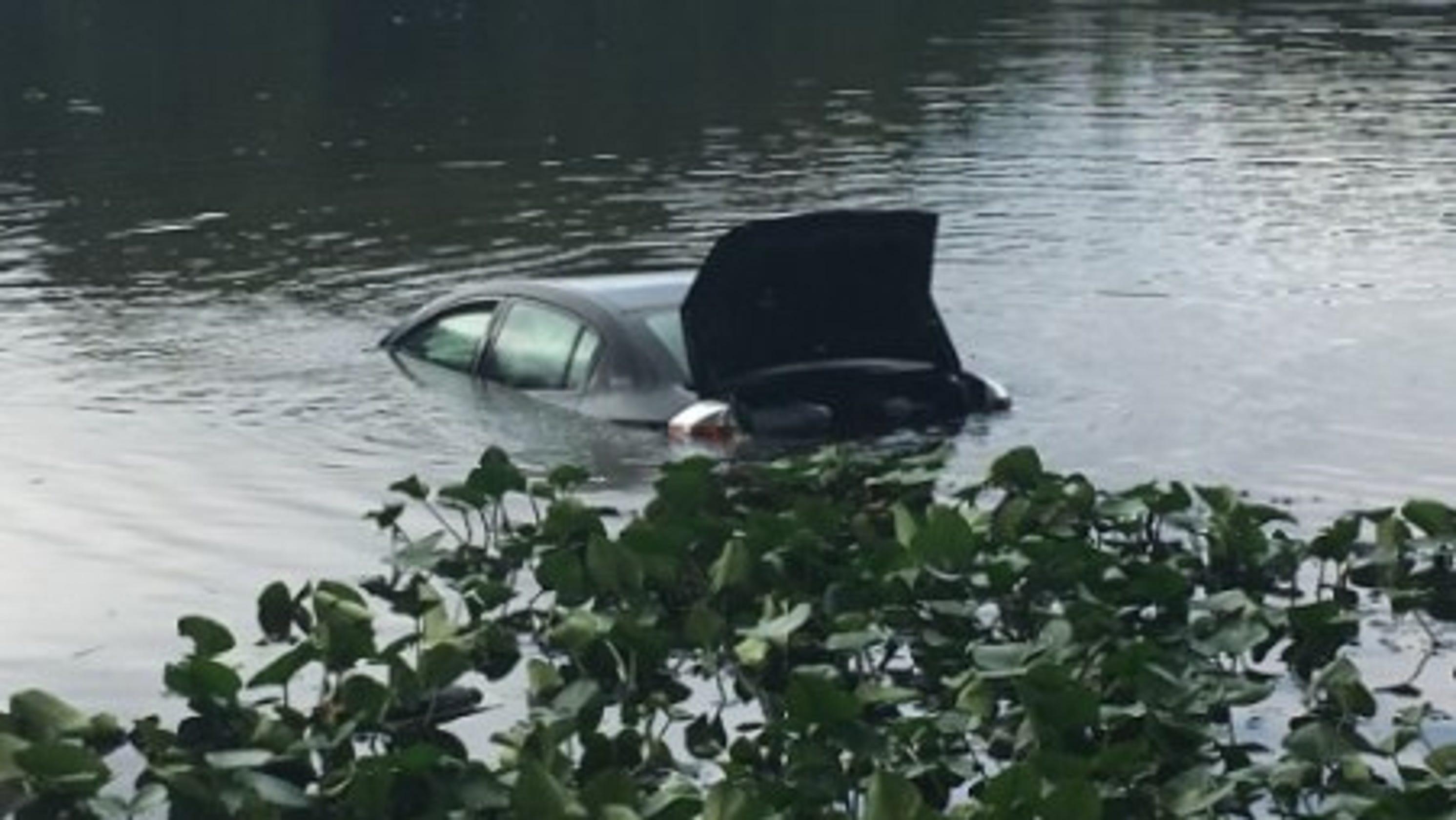 woman girl crash through fence into pond off salem church road