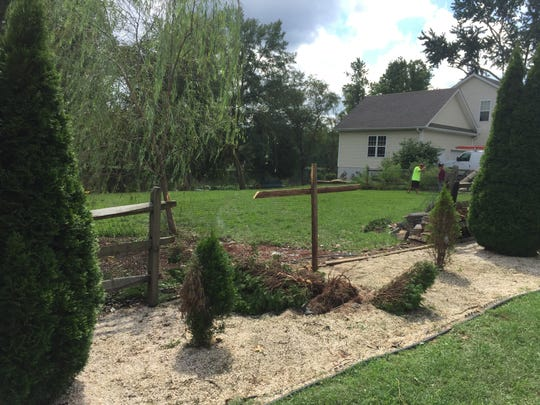 Marc and Julie Iocono made a temporary fix to the fence which was knocked down Sunday morning when a Newark woman missed a curve on Salem Church Road and plowed through their yard. The couple says the road is dangerous and the curve should have a guard rail.