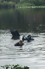 State police helped pull a car out of Becks Pond Sunday morning after a driver crashed into it after slipping off Salem Church Road.