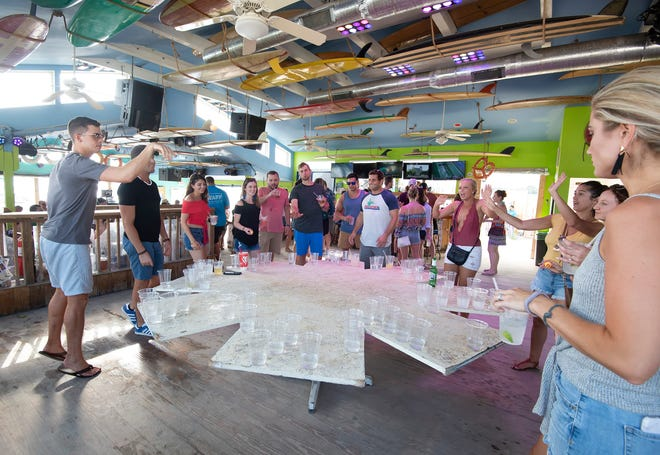 A Labor Day weekend crowd plays beer pong at northbeach in Dewey Beach.