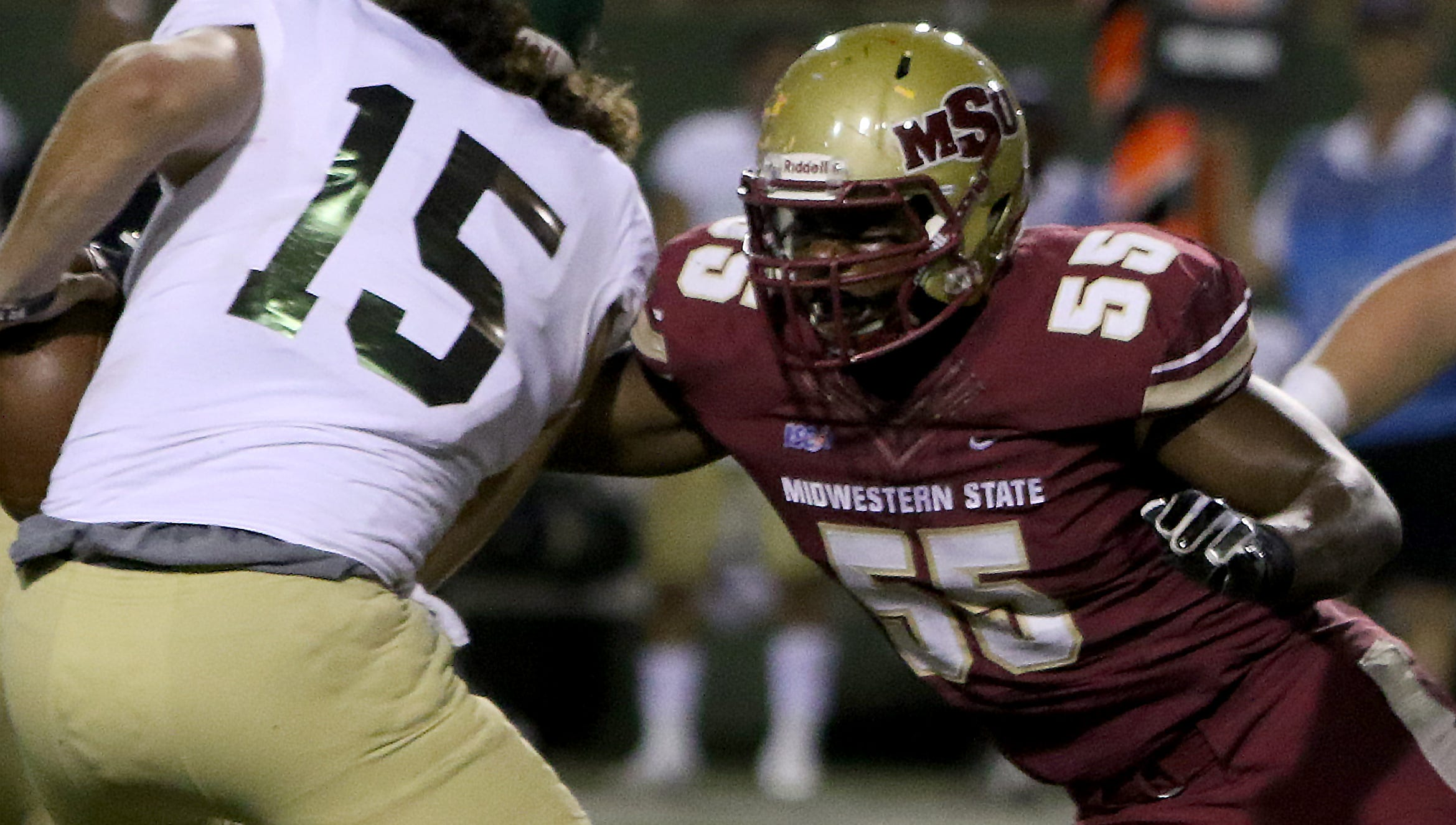 Midwestern State's Melik Owens sacks Humboldt State's Joey Sweeney Saturday, Sept. 1, 2018, at Memorial Stadium. The Mustangs defeated the Jacks 55-12 to open the season.