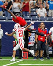 Former Rider standout T.J. Vasher made a sparkling one-handed catch in a 2018 game against Ole Miss.