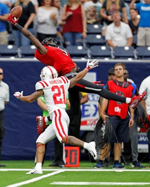 Former Rider standout T.J. Vasher made a sparkling one-handed catch Saturday against Ole Miss.