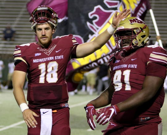 Midwestern State quarterback Layton Rabb congratulates his teammates after they score against Humboldt State Saturday.