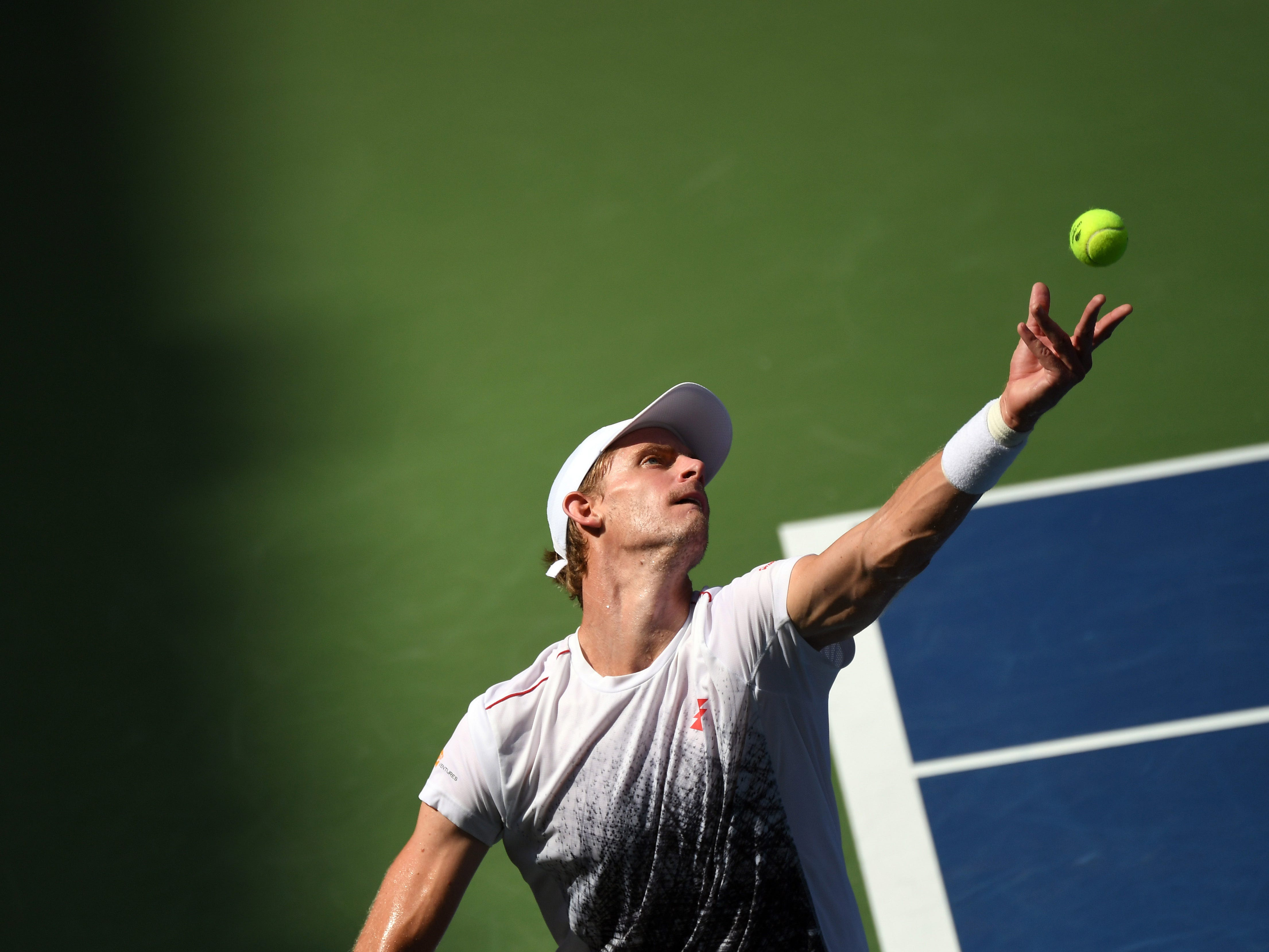 Kevin Anderson of South Africa serves to Dominic Thiem of Austria.