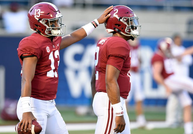 Alabama Crimson Tide quarterbacks Jalen Hurts (2) and Tua Tagovailoa (13) interact before the start of their game against the Louisville Cardinals at Camping World Stadium.