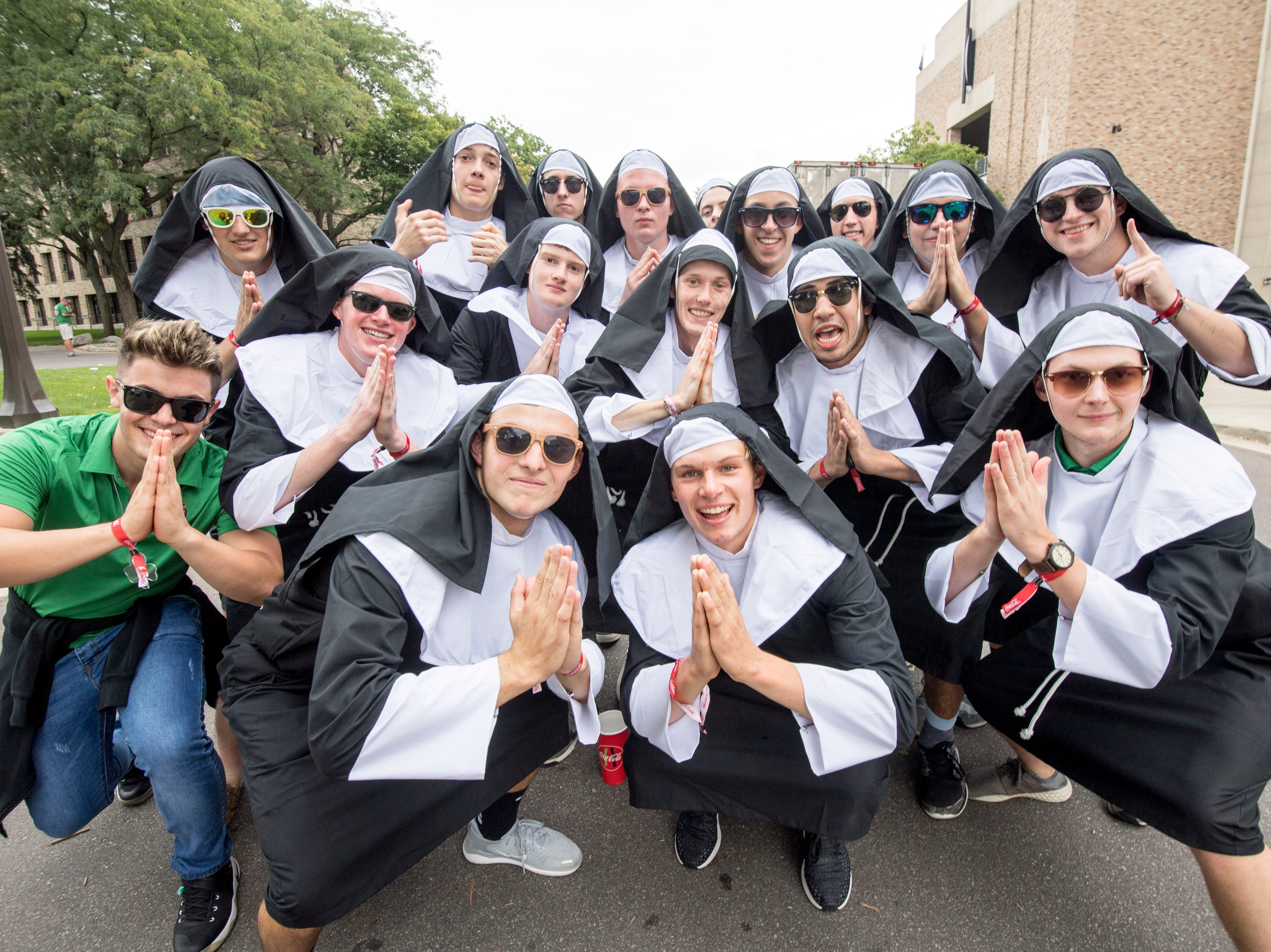 Week 1: Notre Dame students dressed as nuns pose for a photo before the game against the Michigan Wolverines at Notre Dame Stadium.